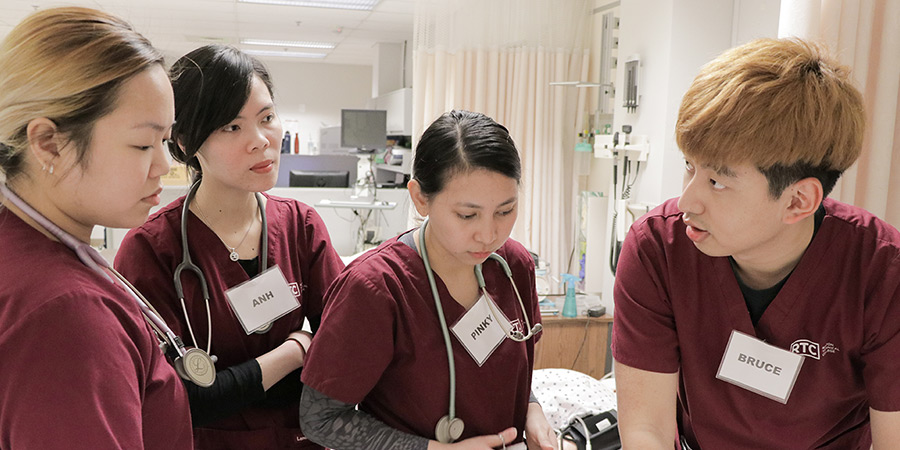 Four nursing students working together