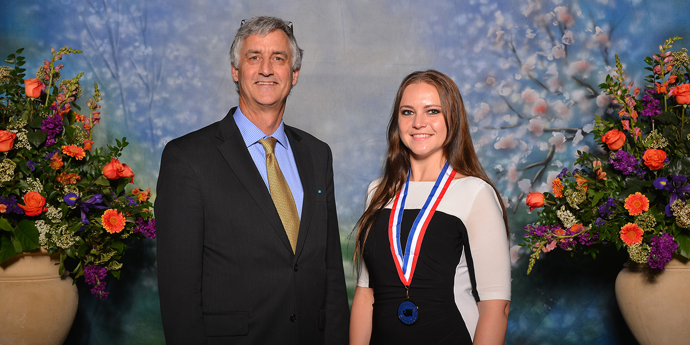 Kathryn Forman poses with her All-WA Academic Team medal next to RTC President Kevin McCarthy