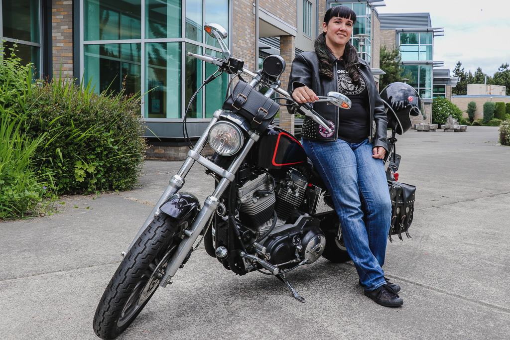 Rachel Houghton sitting on parked motorcycle in front of RTC building C