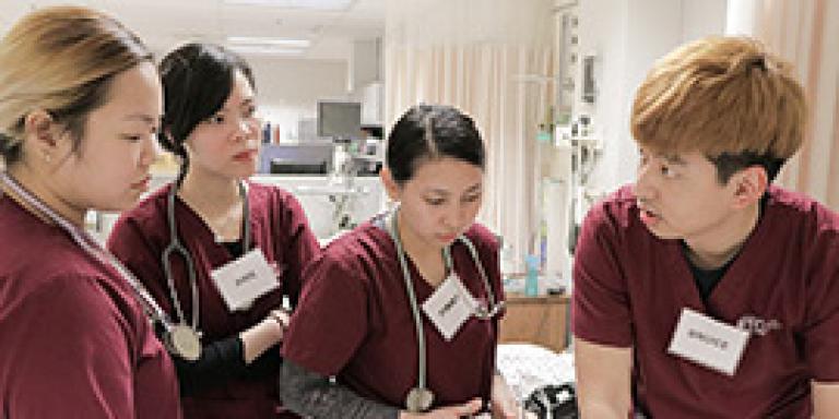 Four nursing students working together
